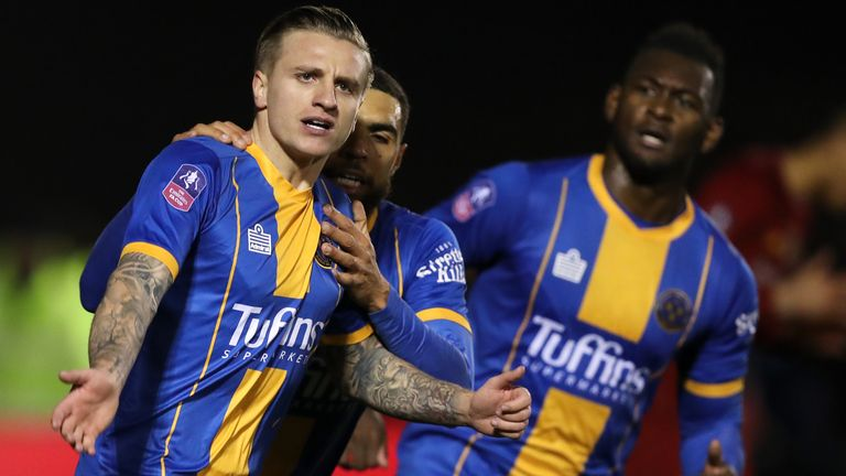 Jason Cummings scored twice off the bench to bring Shrewsbury level against Liverpool