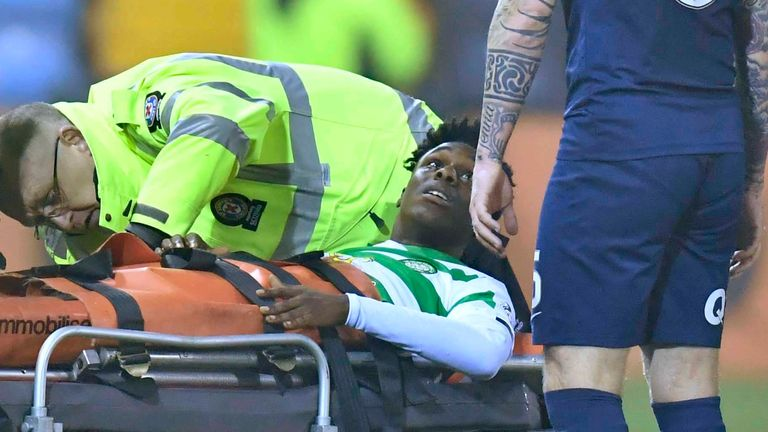 Celtic's Jeremie Frimpong (left) exchanges words with Kilmarnock's Alan Power as he is stretchered off at Rugby Park