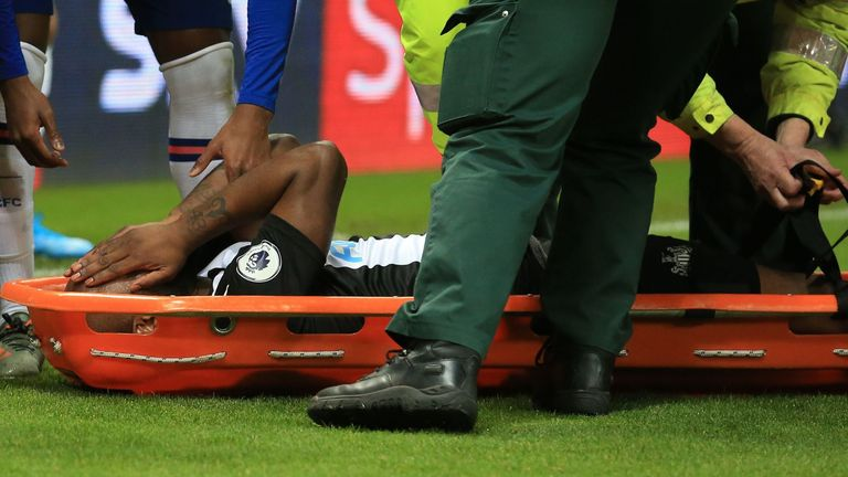 Newcastle United's Dutch defender Jetro Willems reacts as he is stretchered off injured during the English Premier League football match between Newcastle United and Chelsea at St James' Park in Newcastle-upon-Tyne, north east England on January 18, 2020.