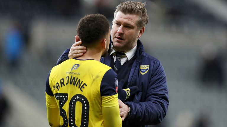 Karl Robinson consoles Marcus Browne after his miss during the draw at St James' park