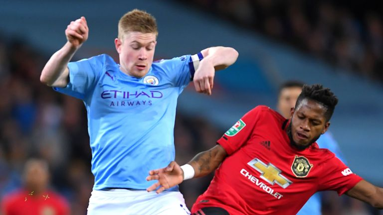 Kevin De Bruyne battles for possession with Fred during Manchester City's Carabao Cup semi-final against Manchester United