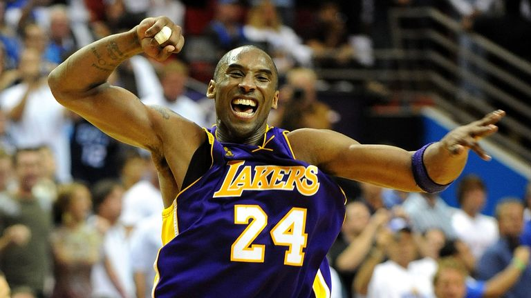 Kobe Bryant #24 of the Los Angeles Lakers celebrates after defeating the Orlando Magic 99-86 in Game Five of the 2009 NBA Finals on June 14, 2009 at Amway Arena in Orlando, Florida.