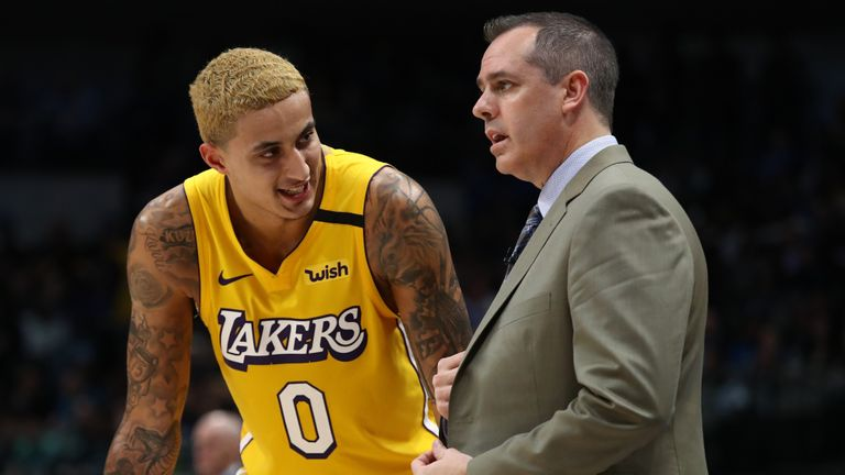Kyle Kuzma #0 of the Los Angeles Lakers and Frank Vogel at American Airlines Center