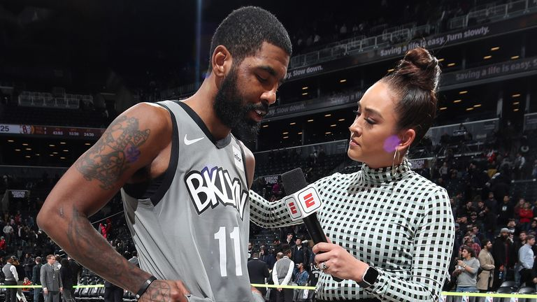 Kyrie Irving is consoled by NBA sideline reporter Cassidy Hubbarth after Brooklyn's win over Detroit