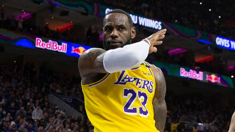 LeBron James #23 of the Los Angeles Lakers reacts in front of Ben Simmons #25 of the Philadelphia 76ers in the fourth quarter at the Wells Fargo Center on January 25, 2020 in Philadelphia, Pennsylvania. The 76ers defeated the Lakers 108-91.