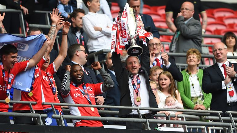 Charlton boss Lee Bowyer celebrates with the Sky Bet League One play-off final trophy