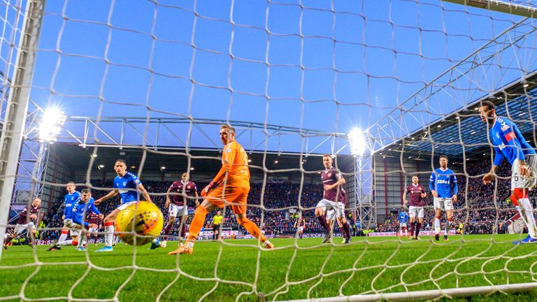Liam Boyce's deflected strike secured a late win for Hearts
