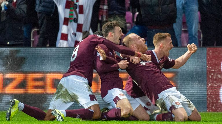 Boyce is mobbed after marking his Hearts debut with a late winner