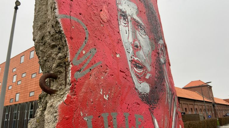A piece of the Berlin Wall painted with a giant image of Eden Hazard sits outside Lille's training base