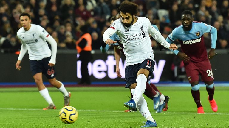 Mohamed Salah fires in from the penalty spot during the first half