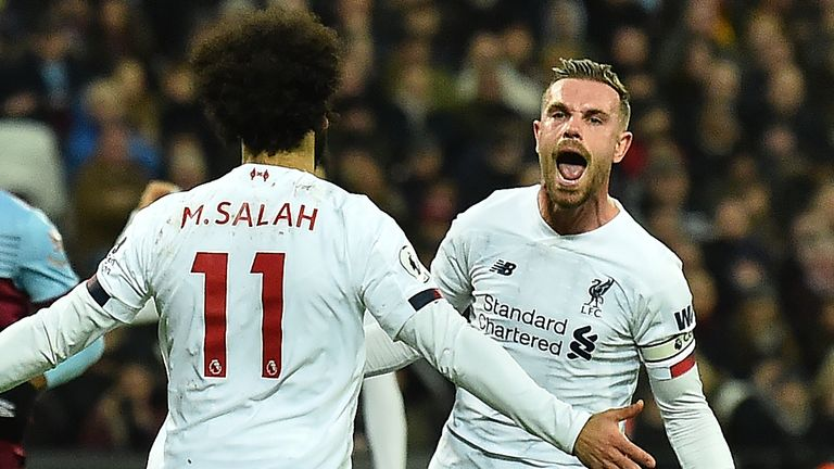 Jordan Henderson celebrates with Mohamed Salah at the London Stadium