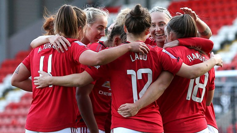 Kirsty Hanson of Manchester United Women celebrates with her team mates