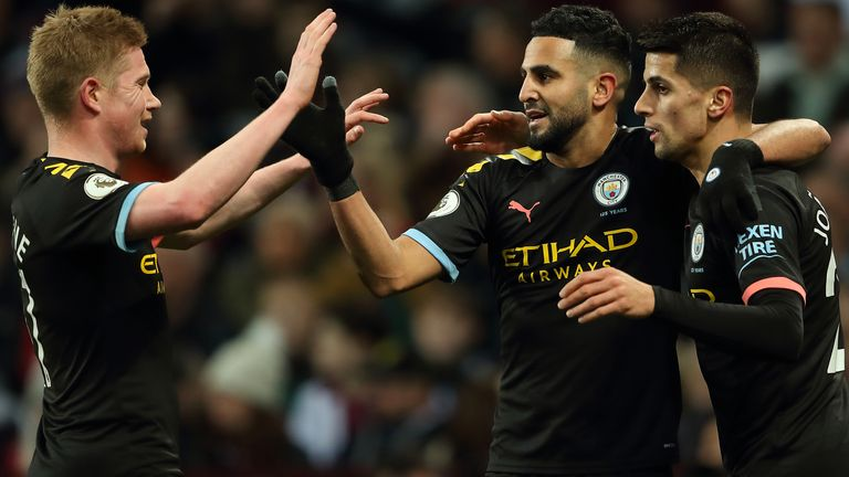 Riyad Mahrez is congratulated by Kevin De Bruyne and Joao Cancelo after his second goal at Aston Villa