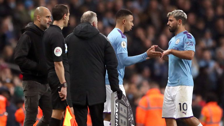 Manchester City's Sergio Aguero (right) is substituted by Gabriel Jesus as Pep Guardiola looks on