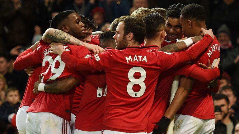 Manchester United celebrate Marcus Rashford's first goal against Norwich on Saturday