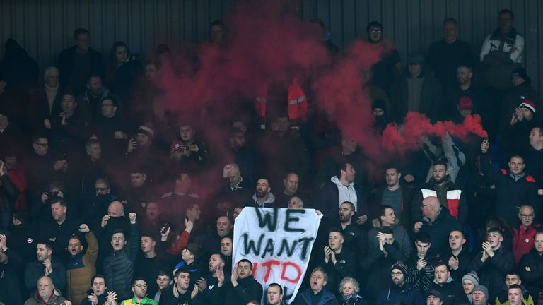 Manchester United fans protest against the owners at their fourth-round FA Cup game against Tranmere