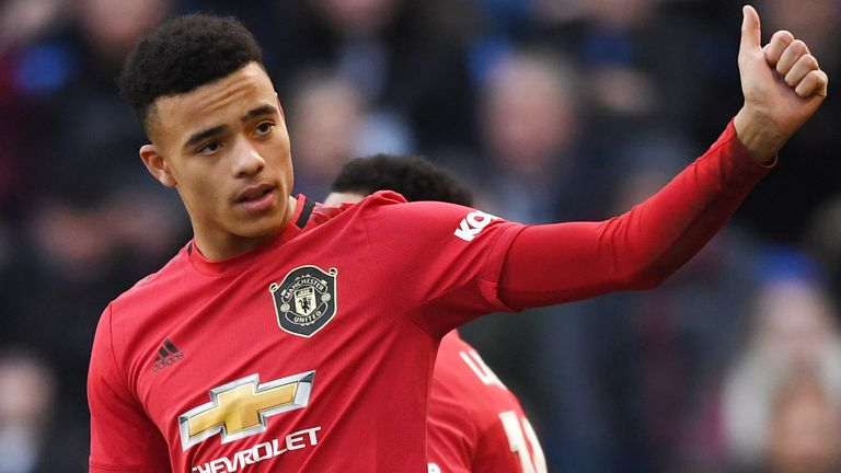 Mason Greenwood celebrates scoring Manchester United's sixth goal against Tranmere from the penalty spot