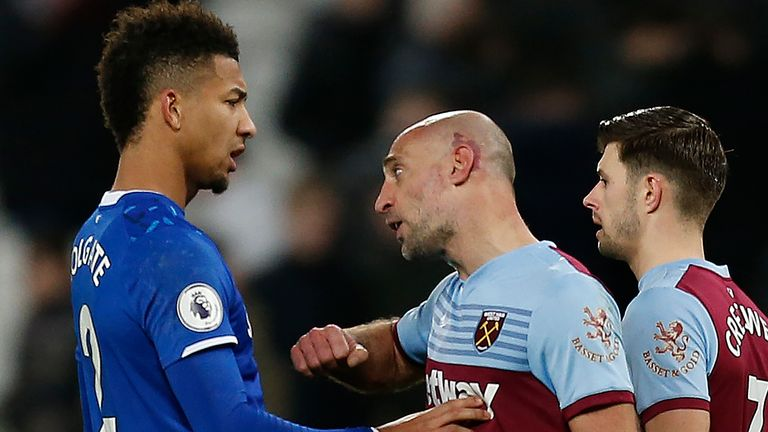 Mason Holgate is confronted by Pablo Zabaleta during the second period
