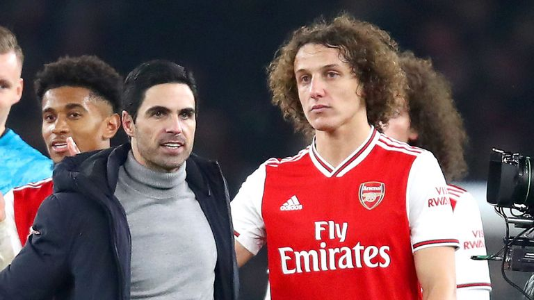 Mikel Arteta and David Luiz leave the pitch after the recent 2-0 win over Manchester United