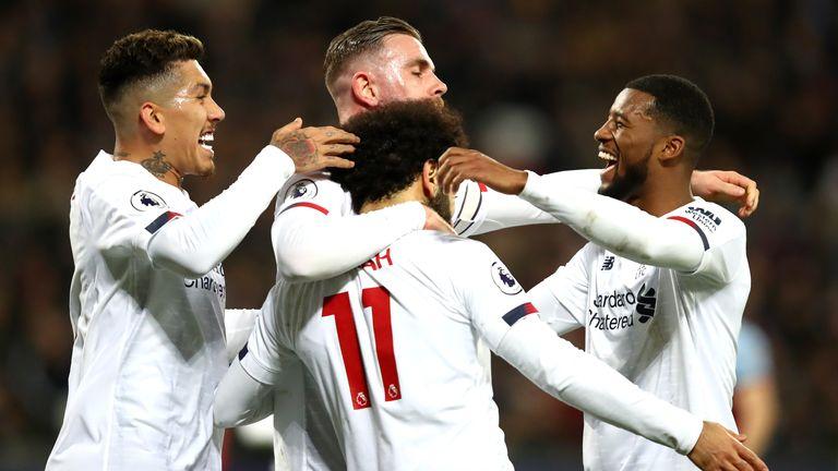 Mohamed Salah celebrates with Liverpool team-mates after scoring against West Ham