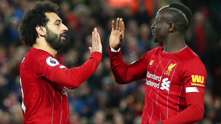 Mohamed Salah of Liverpool celebrates with Sadio Mane after scoring his team's first goal during the Premier League match between Liverpool FC and Sheffield United at Anfield on January 02, 2020 in Liverpool, United Kingdom. (