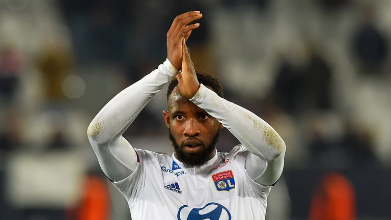Lyon's French forward Moussa Dembele applauds his supporters at the end of the French L1 football match between FC Girondins de Bordeaux and Olympique Lyonnais at the Matmut Atlantique stadium in Bordeaux, southwestern France on January 11, 2020.