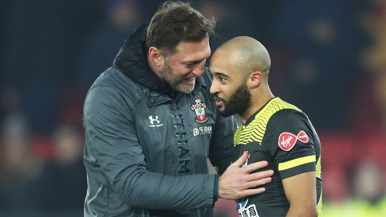 Redmond is congratulated by his manager after a superb display for his side