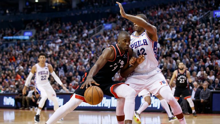 : Serge Ibaka #9 of the Toronto Raptors drives to the net against Al Horford #42 of the Philadelphia 76ers during second half of their NBA game at Scotiabank Arena on January 22, 2020 in Toronto, Canada.