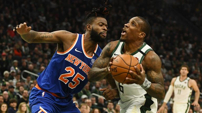 Eric Bledsoe #6 of the Milwaukee Bucks is defended by Reggie Bullock #25 of the New York Knicks during the first half of a game at Fiserv Forum on January 14, 2020 in Milwaukee, Wisconsin.