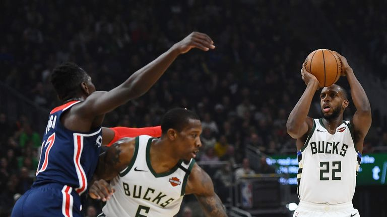 Khris Middleton #22 of the Milwaukee Bucks takes a three point shot during the first half of a game against the Washington Wizards at Fiserv Forum on January 28, 2020 in Milwaukee, Wisconsin.