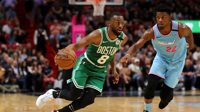 Kemba Walker #8 of the Boston Celtics drives to the basket against Jimmy Butler #22 of the Miami Heat during the second half at American Airlines Arena on January 28, 2020 in Miami, Florida.