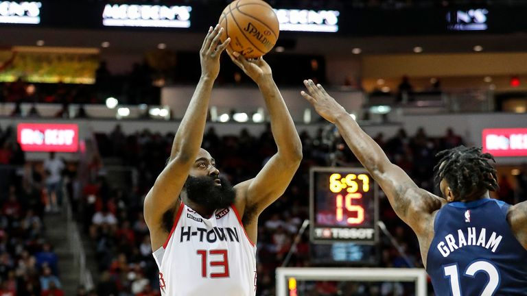 James Harden #13 of the Houston Rockets drives to the basket defended by Robert Covington #33 of the Minnesota Timberwolves in the first half at Toyota Center on January 11, 2020 in Houston, Texas.