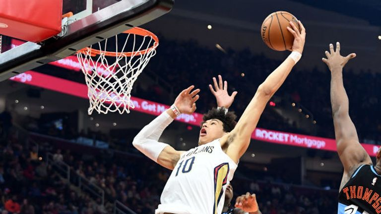 Jaxson Hayes #10 of the New Orleans Pelicans dunks over Tristan Thompson #13 and Kevin Porter Jr. #4 of the Cleveland Cavaliers during the first half at Rocket Mortgage Fieldhouse on January 28, 2020 in Cleveland, Ohio.