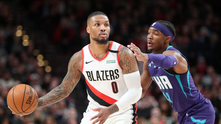Damian Lillard #0 of the Portland Trail Blazers handles the ball against Devonte' Graham #4 of the Charlotte Hornets in the first quarter at Moda Center on January 13, 2020 in Portland, Oregon.