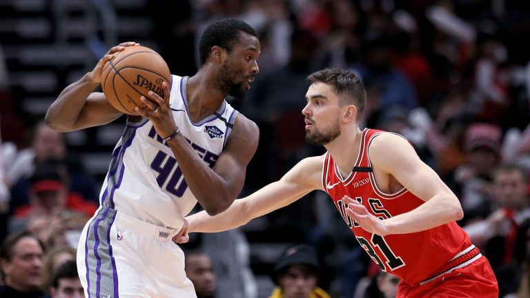 Harrison Barnes #40 of the Sacramento Kings handles the ball while being guarded by Tomas Satoransky #31 of the Chicago Bulls in the third quarter at the United Center on January 24, 2020 in Chicago, Illinois.