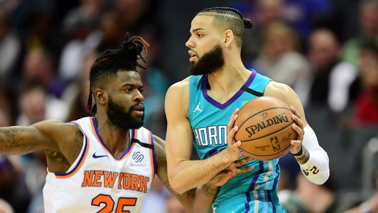 Reggie Bullock #25 of the New York Knicks defends Cody Martin #11 of the Charlotte Hornets during the second quarter at Spectrum Center on January 28, 2020 in Charlotte, North Carolina.