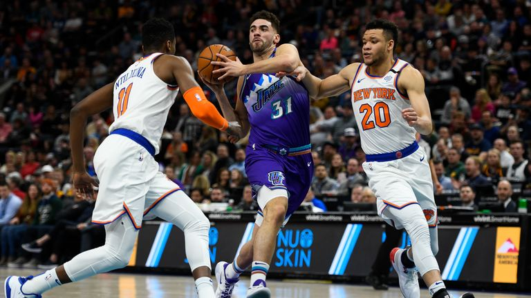 Georges Niang #31 of the Utah Jazz drives between Frank Ntilikina #11 and Kevin Knox II #20 of the New York Knicks during a game at Vivint Smart Home Arena on January 8, 2019 in Salt Lake City, Utah.