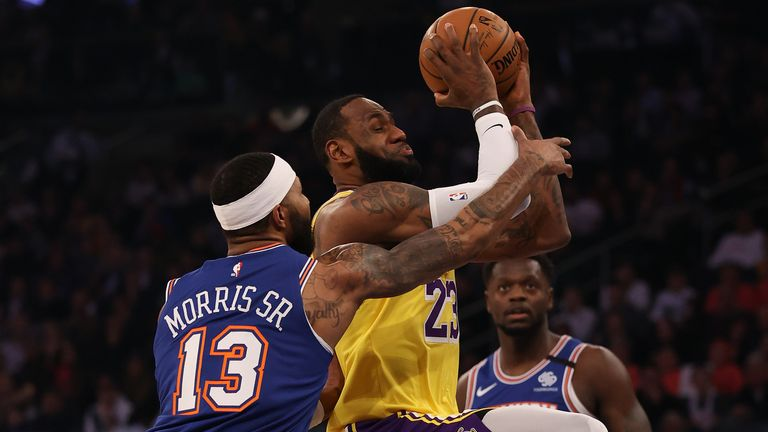 LeBron James #23 of the Los Angeles Lakers is fouled by Marcus Morris Sr. #13 of the New York Knicks in the first quarter at Madison Square Garden on January 22, 2020 in New York City.