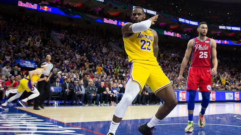 LeBron James #23 of the Los Angeles Lakers reacts in front of Ben Simmons #25 of the Philadelphia 76ers in the fourth quarter at the Wells Fargo Center on January 25, 2020 in Philadelphia, Pennsylvania.