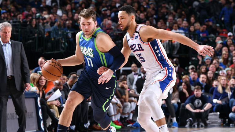 Luka Doncic #77 of the Dallas Mavericks handles the ball while Ben Simmons #25 of the Philadelphia 76ers plays defense during the game on January 11, 2020 at the American Airlines Center in Dallas, Texas.