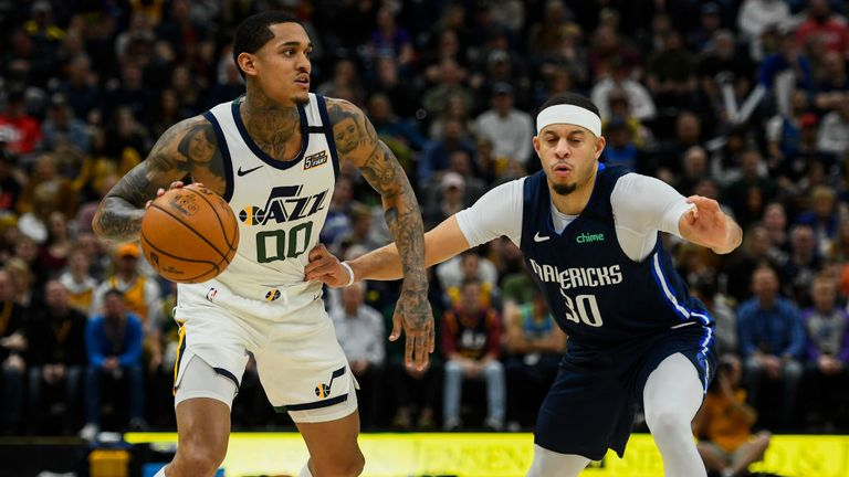 Seth Curry #30 of the Dallas Mavericks guards Jordan Clarkson #00 of the Utah Jazz during a game at Vivint Smart Home Arena on January 25, 2019 in Salt Lake City, Utah.