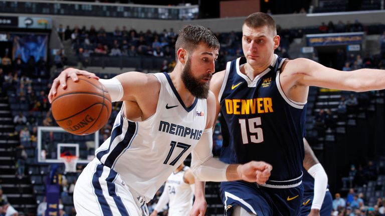 onas Valanciunas #17 of the Memphis Grizzlies drives to the basket while defended by Nikola Jokic #15 of the Denver Nuggets in the second half of a game at FedExForum on January 28, 2020 in Memphis, Tennessee.