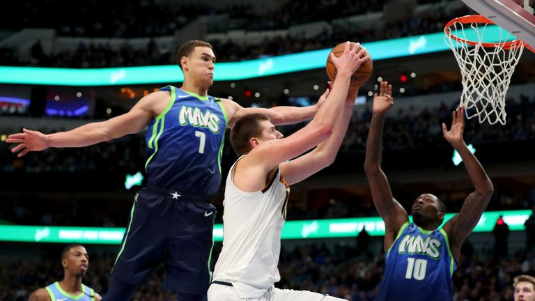 Nikola Jokic #15 of the Denver Nuggets drives to the basket against Dwight Powell #7 of the Dallas Mavericks in the second half at American Airlines Center on January 08, 2020 in Dallas, Texas.