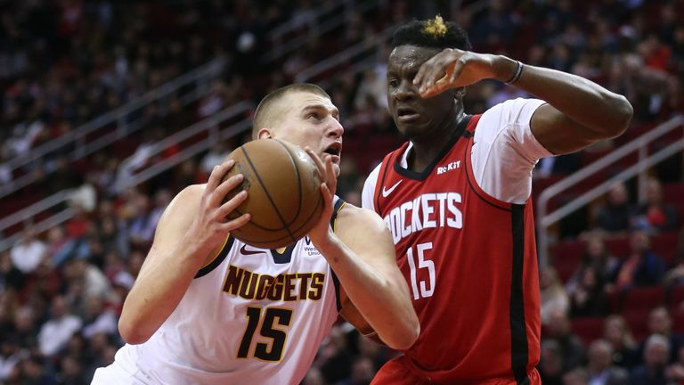 Nikola Jokic #15 of the Denver Nuggets drives on Clint Capela #15 of the Houston Rockets during the fourth quarter at Toyota Center on January 22, 2020 in Houston, Texas.