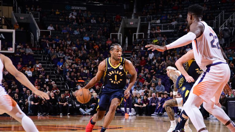 T.J. Warren #1 of the Indiana Pacers handles the ball against the Phoenix Suns on January 22, 2020 at Talking Stick Resort Arena in Phoenix, Arizona.