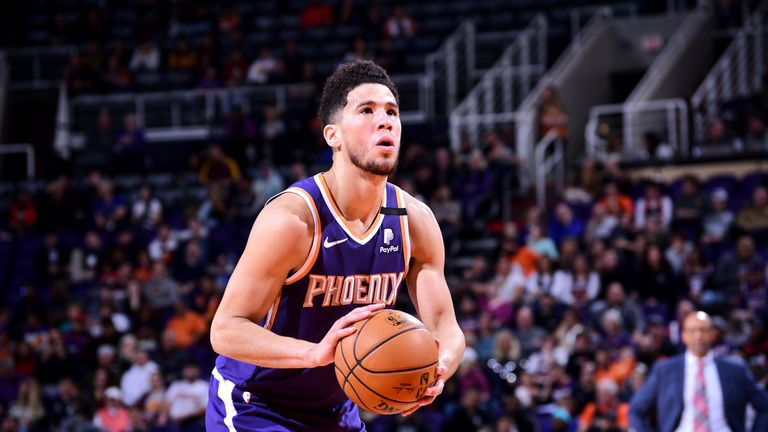 Devin Booker #1 of the Phoenix Suns shoots a free throw during a game against the Memphis Grizzlies