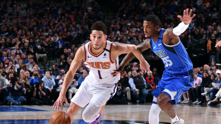Devin Booker #1 of the Phoenix Suns drives to the basket against the Dallas Mavericks on January 28, 2020 at the American Airlines Center in Dallas, Texas.
