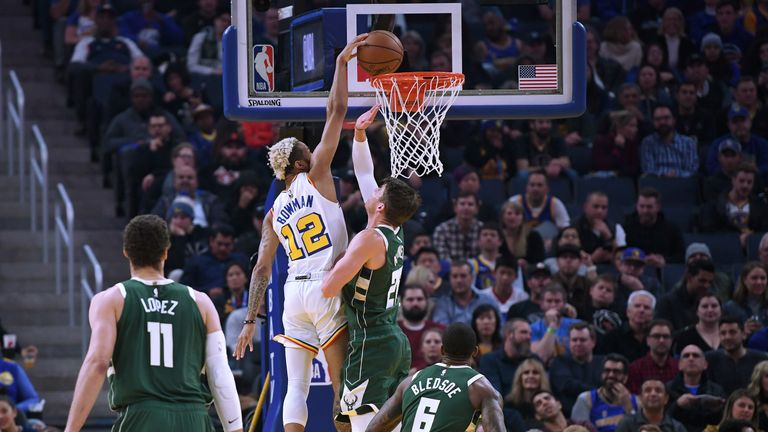 Ky Bowman #12 of the Golden State Warriors slam dunks over Kyle Korver #26 of the Milwaukee Bucks during the first half of an NBA basketball game at Chase Center on January 08, 2020 in San Francisco, California.