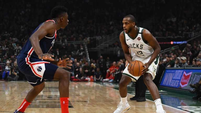 Khris Middleton #22 of the Milwaukee Bucks is defended by Thomas Bryant #13 of the Washington Wizards during the first half at Fiserv Forum on January 28, 2020 in Milwaukee, Wisconsin.