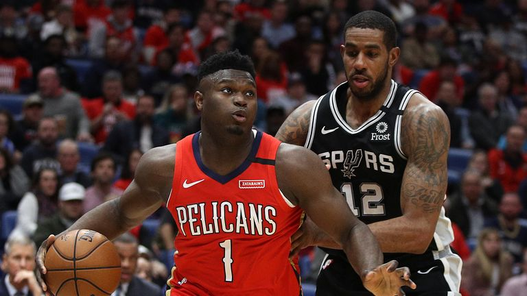 Zion Williamson #1 of the New Orleans Pelicans drives the ball around LaMarcus Aldridge #12 of the San Antonio Spurs at Smoothie King Center on January 22, 2020 in New Orleans, Louisiana.